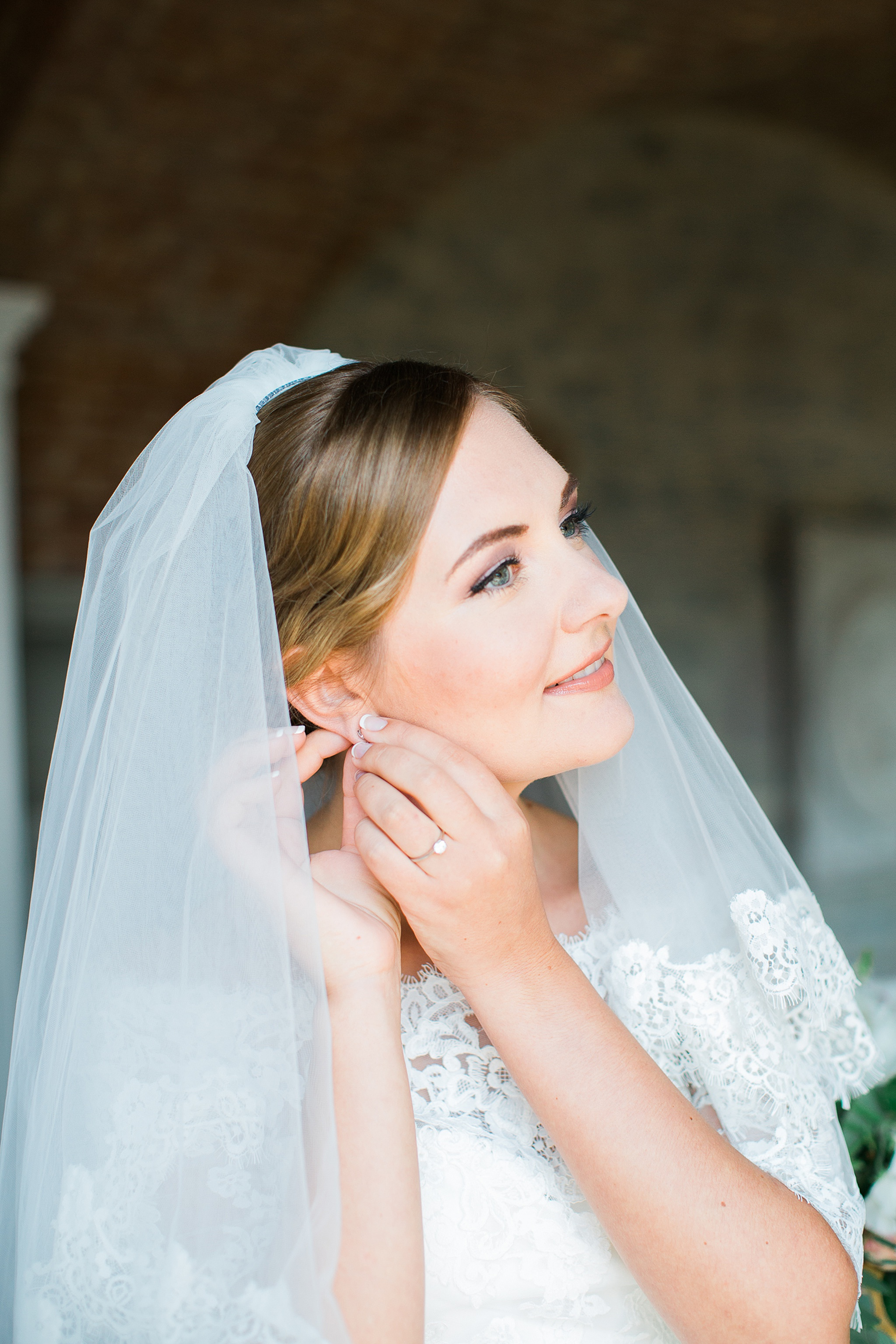 bride-putting-on-earrings