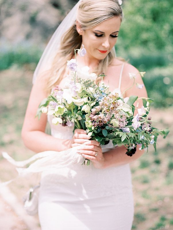 Intimate Central Park wedding bride holding bouquet