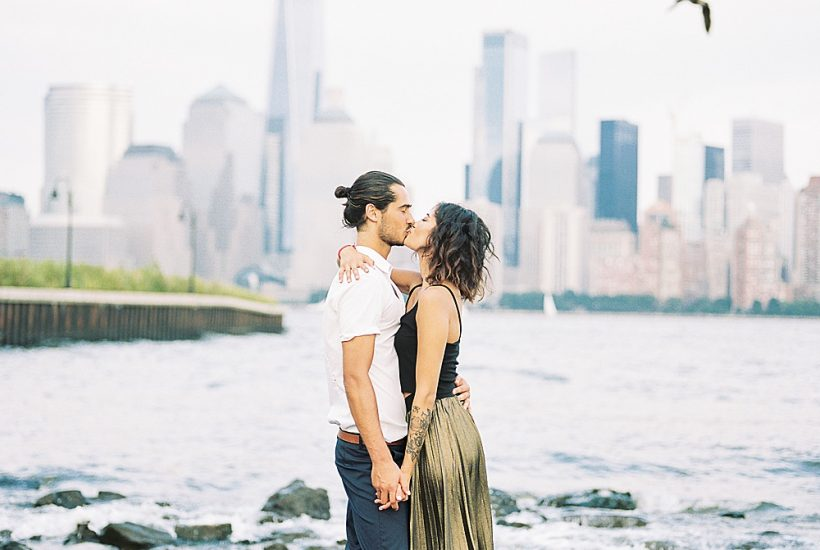 birds flying over couple kissing NYC