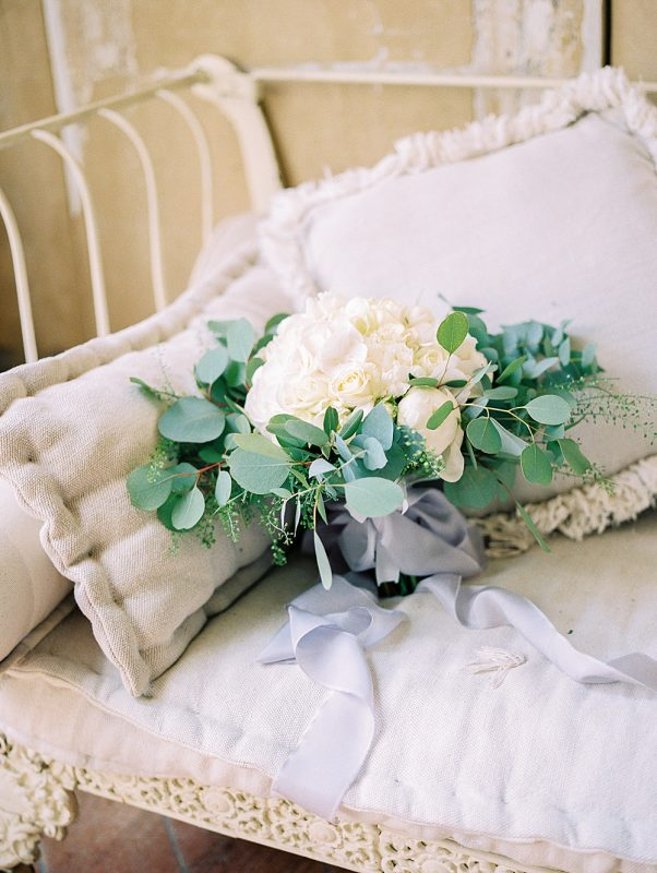 bridal bouquet on chaise