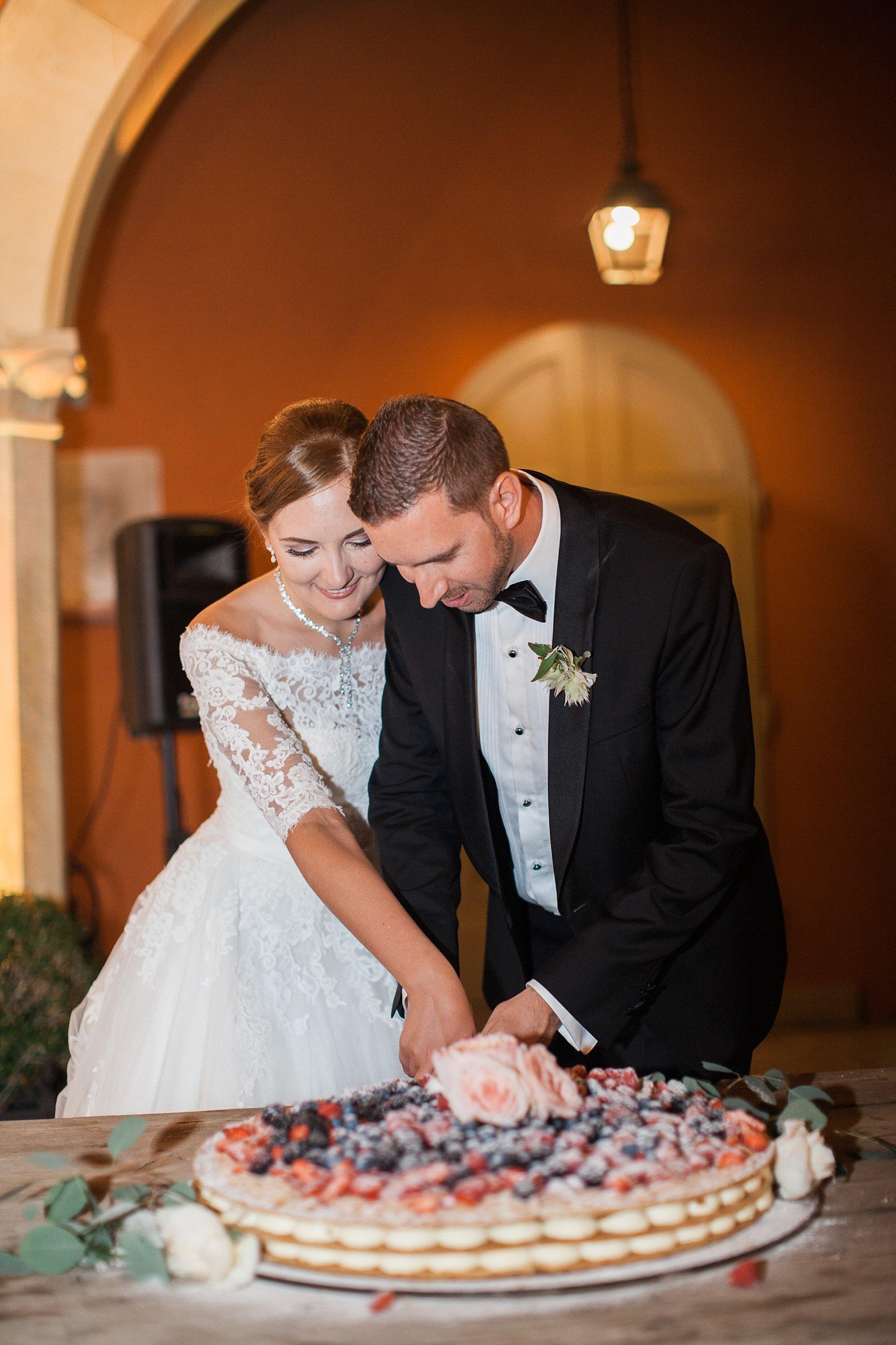 couple-cutting-wedding-cake